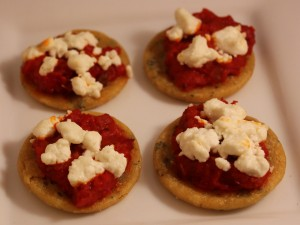 Mini Socca Pizza with goat cheese and red pepper eggplant tapenade