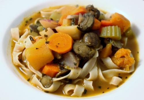 hearty mushroom and veg soup over egg noodles